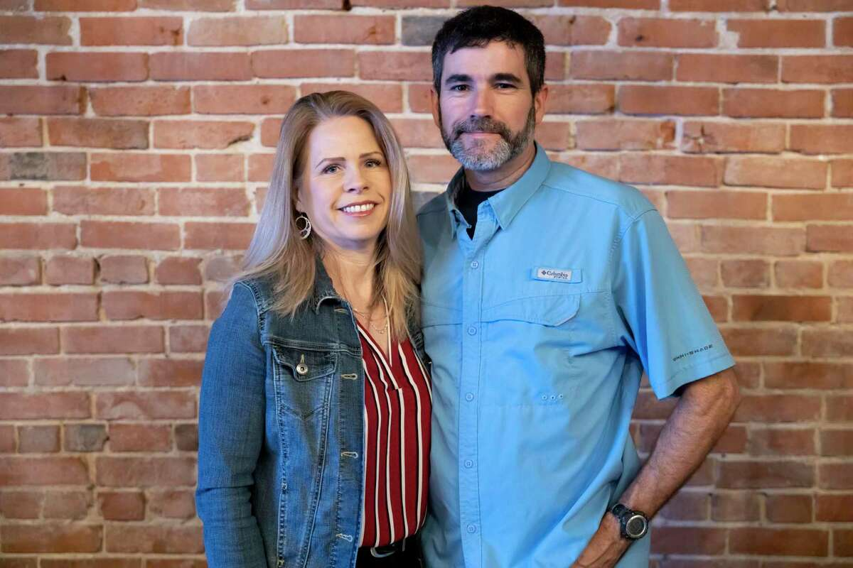 Mike and Cathy Rape pose for a portrait inside of their new business, The Ferm Meadery, Friday, Feb. 5, 2021, in downtown Conroe. The Ferm will operate as a new brewery and wine tasting room and plans to open at the end of February.