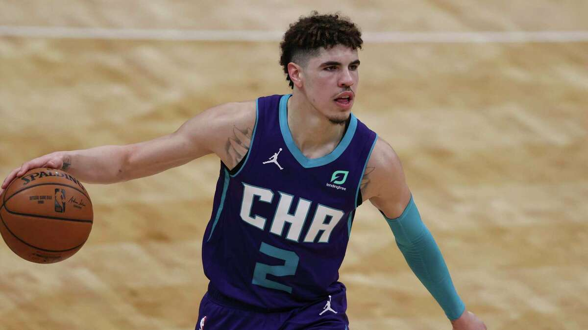 Charlotte Hornets guard LaMelo Ball brings the ball up court against the Houston Rockets in the second half of an NBA basketball game in Charlotte, N.C., Monday, Feb. 8, 2021. Charlotte won 119-94. (AP Photo/Nell Redmond)