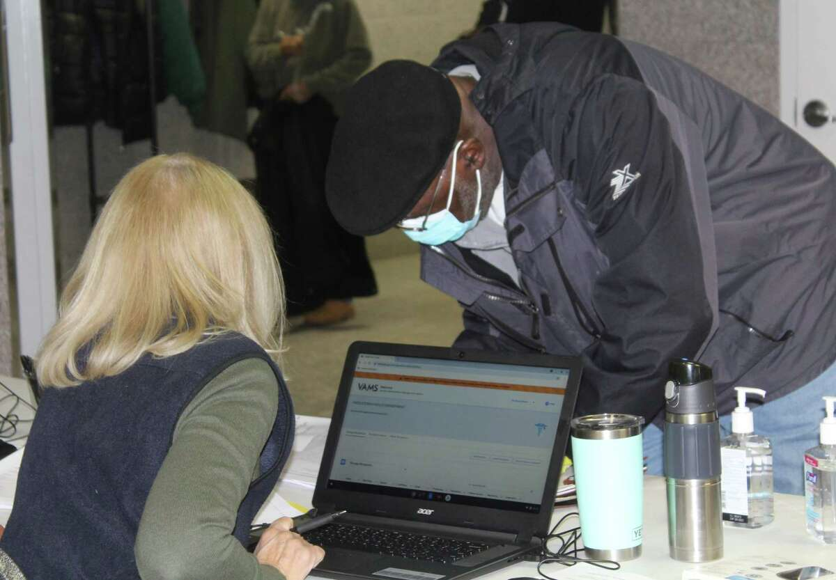 Individuals receive their COVID-19 vaccines at Cross Street AME Zion Church, 440 West St., Middletown.