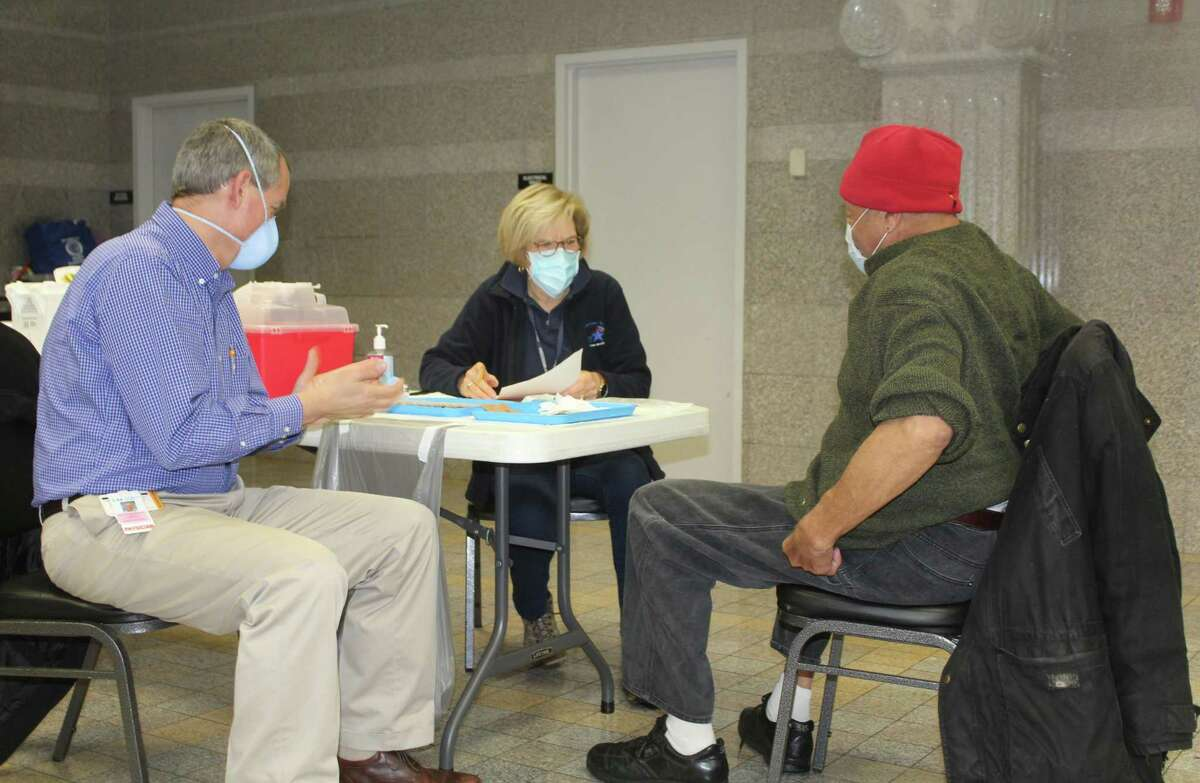 People receive the COVID-19 vaccine earlier this month at Cross Street AME Zion Church in Middletown.