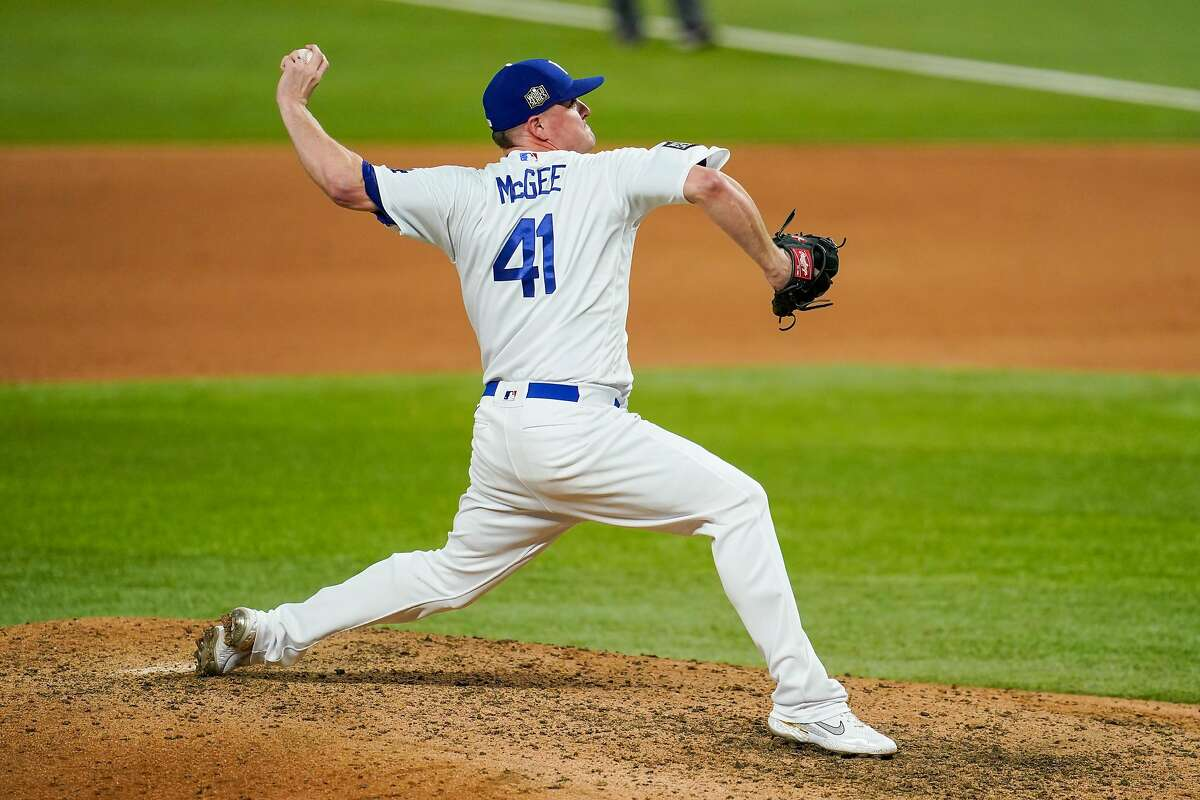 ARLINGTON, TX - OCTOBER 21: Jake McGee #41 of the Los Angeles Dodgers pitches in the ninth inning during Game 2 of the 2020 World Series between the Los Angeles Dodgers and the Tampa Bay Rays at Globe Life Field on Wednesday, October 21, 2020 in Arlington, Texas. (Photo by Cooper Neill/MLB Photos via Getty Images)