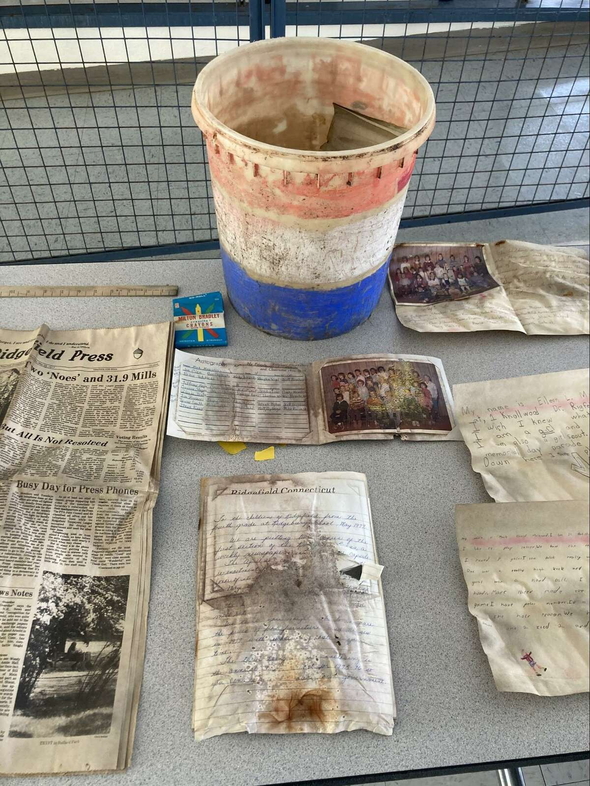 Some of the objects found in the container, including a copy of the Ridgefield Press