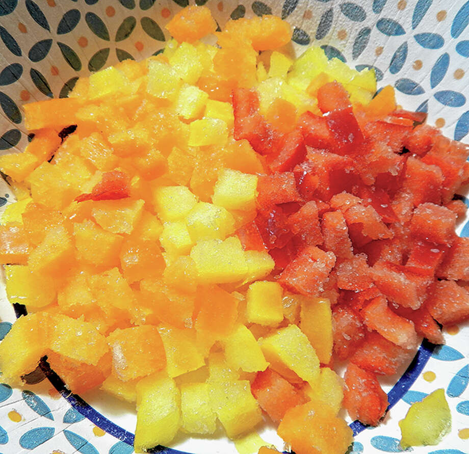 A blend of chopped red, orange and yellow peppers fills in for green peppers in an impromptu gumbo-making session. Photo: Angela Bauer   Journal-Courier