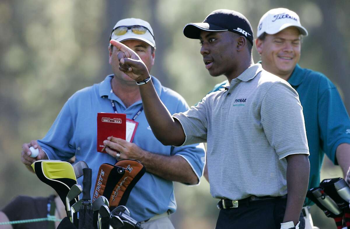 Deaf golfer Kevin Hall gestures to his caddie, Dennis Mitchell, during his 2006 practice round at Spyglass Hill. Hall, now 38, returns to the AT&T Pebble Beach Pro-Am this week.