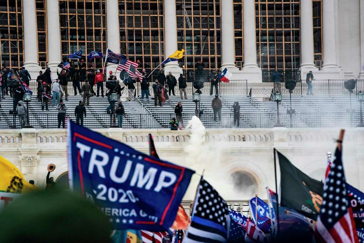 Supporters of US President Donald Trump clash with the US Capitol police during a riot at the US Capitol on Jan. 6, 2021, in Washington, DC. (Alex Edelman/AFP/Getty Images/TNS)