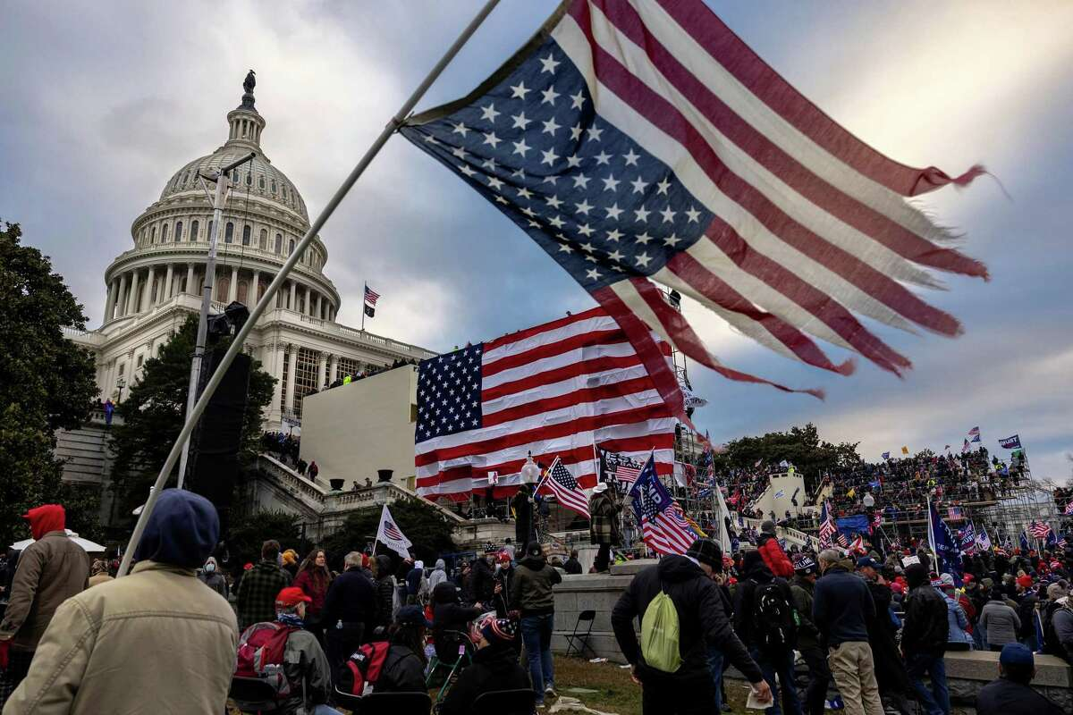 Pro-Trump protesters gather in front of the U.S. Capitol Building on January 6, 2021, in Washington, DC. Trump supporters gathered in the nation's capital to protest the ratification of President-elect Joe Biden's Electoral College victory over President Trump in the 2020 election. A pro-Trump mob later stormed the Capitol, breaking windows and clashing with police officers. (Brent Stirton/Getty Images/TNS)
