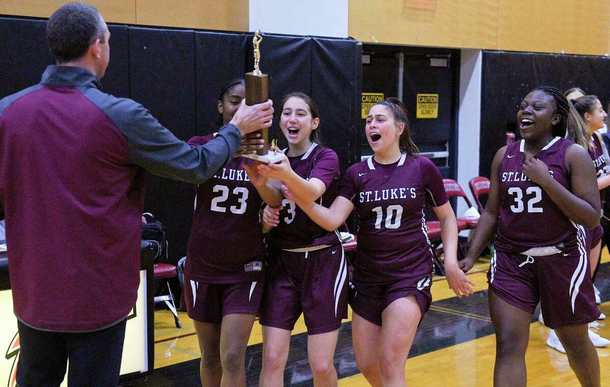 St. Luke's defeated Green Farm Academy 76-55 in the FAA girls basketball final in New Canaan in 2020.