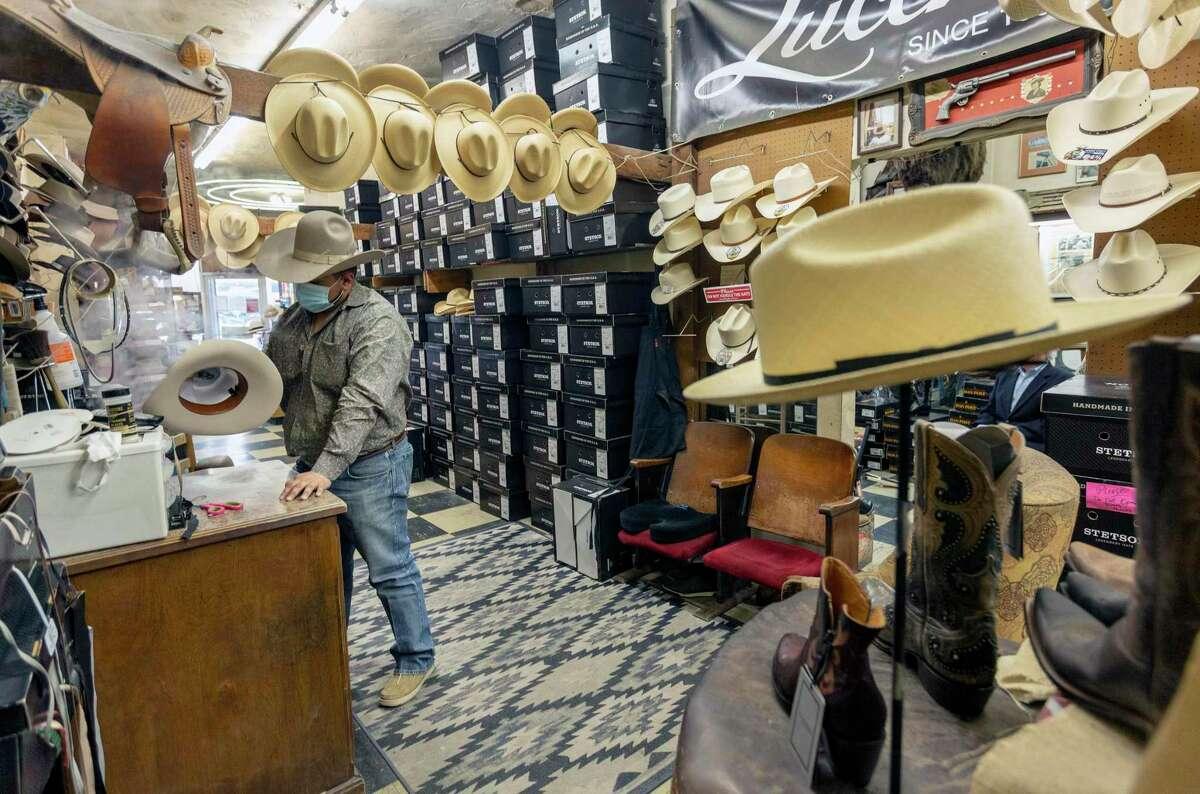 Luis Martinez blocks, or shapes, a hat. Paris Hatters also refurbishes worn hats..