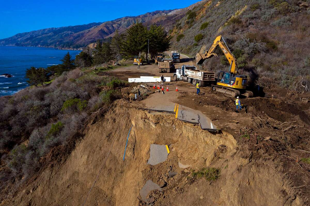 Caltrans and construction crews work on the collapsed Highway 1 near Rat Creek in Big Sur on Thursday.