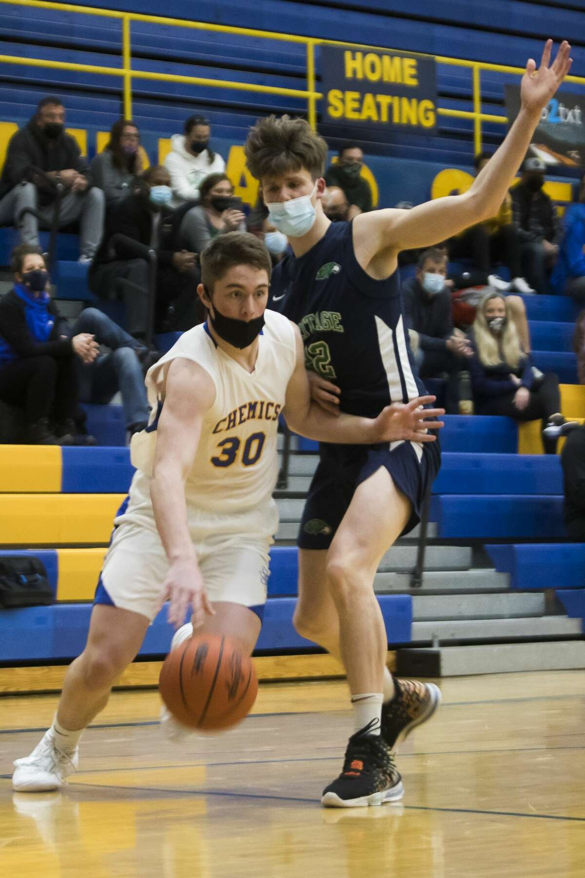 Midland's Drew Barrie dribbles down the court during the Chemics' game against Saginaw Heritage Tuesday, Feb. 9, 2021 at Midland High School. (Katy Kildee/kkildee@mdn.net)