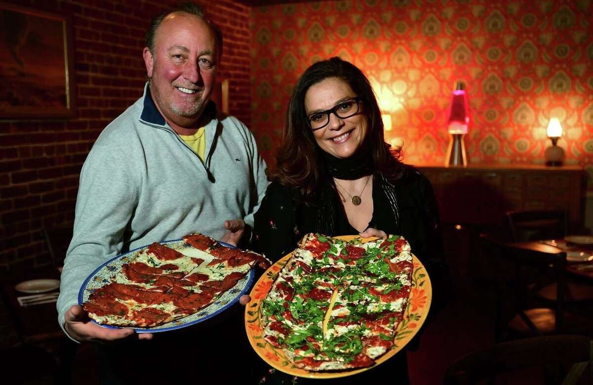 Coal's Grilled Pizza owners Joe Rossi and Blanca Restaino Tuesday at the restaurant in Norwalk. Coal's Grilled Pizza, which has locations in Westchester, opened their new location on Wall Street last Friday. It's the group's first location in Fairfield County/Connecticut and replaces Fat Cat Pizzeria which closed on Wall Street last year.