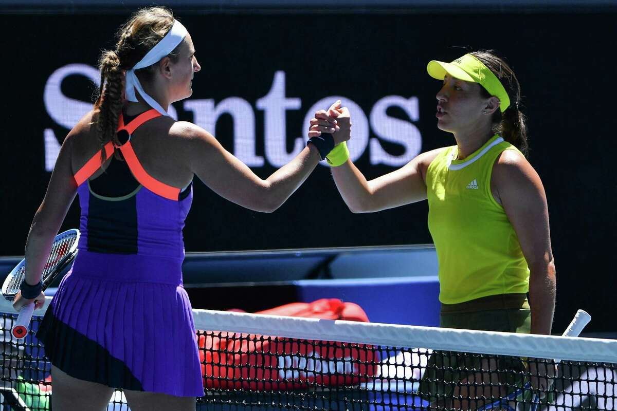 Jessica Pegula of the US (R) shakes hands with Belarus' Victoria Azarenka after winning in the women's singles match on day two of the Australian Open tennis tournament in Melbourne on February 9, 2021. (Photo by Paul CROCK / AFP) / -- IMAGE RESTRICTED TO EDITORIAL USE - STRICTLY NO COMMERCIAL USE -- (Photo by PAUL CROCK/AFP via Getty Images)