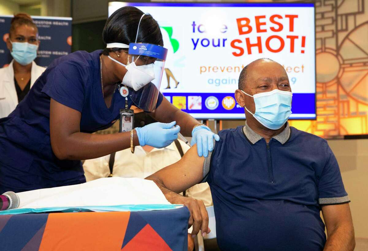 Houston Mayor Sylvester Turner gets his first dose of Moderna COVID-19 vaccine Monday, Jan. 4, 2021, at City Hall in Houston.