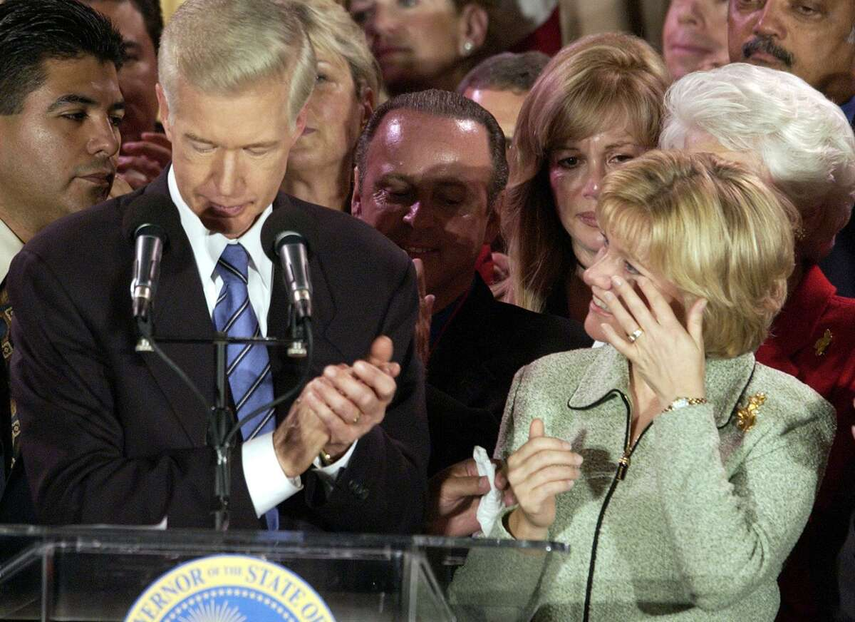 Sharon Davis wipes away a tear as her husband California Governor Gray Davis concedes his recall to supporters at his election night headquarters in Los Angeles on Oct. 7, 2003.