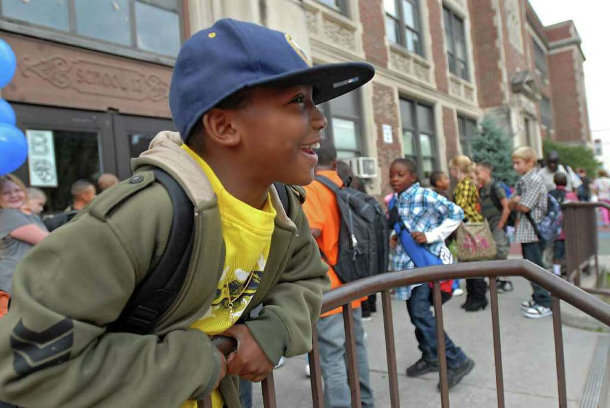 Kiam Vaughan,10, of Troy watches as students arrive for first day of classes at School 12 in Troy on Tuesday, Sept. 7, 2010. (Lori Van Buren / Times Union)