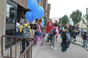 Students arrive to first day of classes at School 12 in Troy on Tuesday, Sept. 7, 2010. (Lori Van Buren / Times Union)