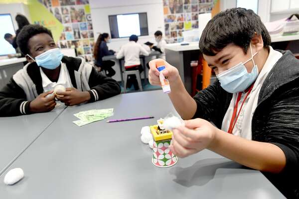 Martin Luther King, Jr., Middle School sixth-graders (from left) Xzaidrien Slaughter and Jovany Mondragon teamed up to build a safe space capsule during a session in Learning Undefeated's Texas Mobile STEM Lab Tuesday. Photo taken Tuesday, February 9, 2021 Kim Brent/The Enterprise