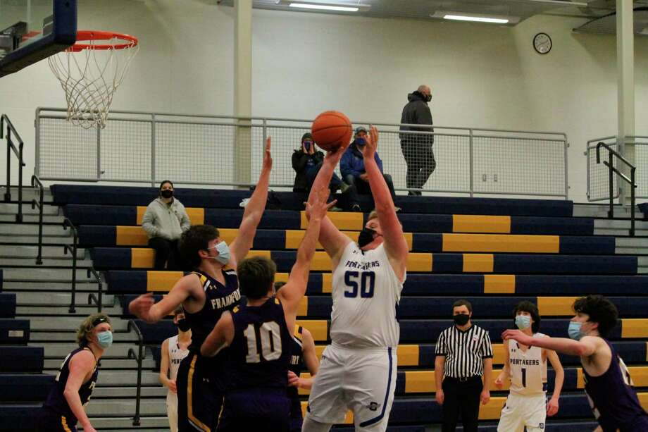 Adam Domres goes up with a shot in the paint. (Robert Myers/News Advocate)
