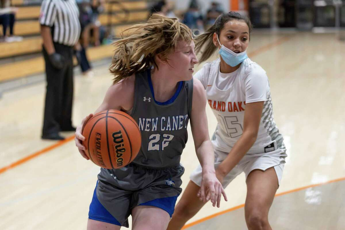 New Caney's Abby Dittman (22), shown here earlier in the season, had a double-double Tuesday night in a win over Lake Creek.