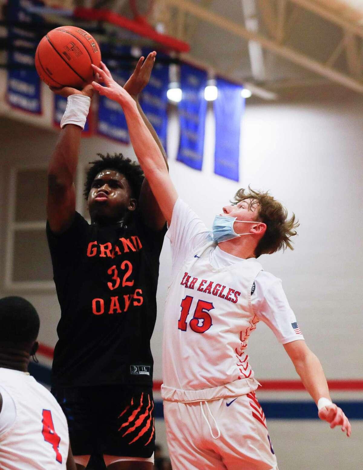 Oak Ridge's Justin Bryant (15) blocks a shot by Grand Oaks' Samuel Nkassa (32) during the first quarter of a District 13-6A high school basketball game at Oak Ridge High School, Tuesday, Feb. 9, 2021.