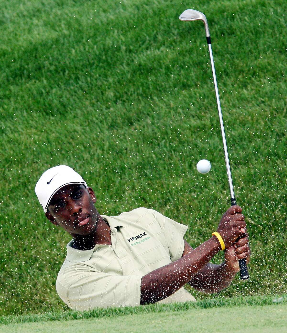 Former Ohio State golfer Kevin Hall hits out of the bunker on the 18th hole during a practice round at the 2006 Memorial golf tournament at the Muirfield Village Golf Club, Tuesday, May 30, 2006, in Dublin, Ohio (AP Photo/Terry Gilliam)