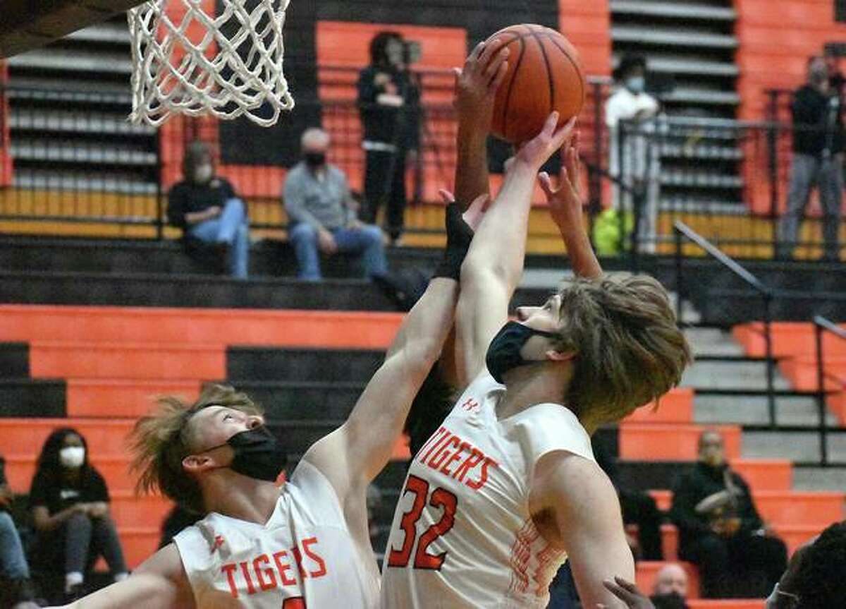 Edwardsville's Shaun Pacette, right, and Hayden Moore go up for a rebound in the first half of Tuesday's game against O'Fallon inside Lucco-Jackson Gymnasium in Edwardsville.