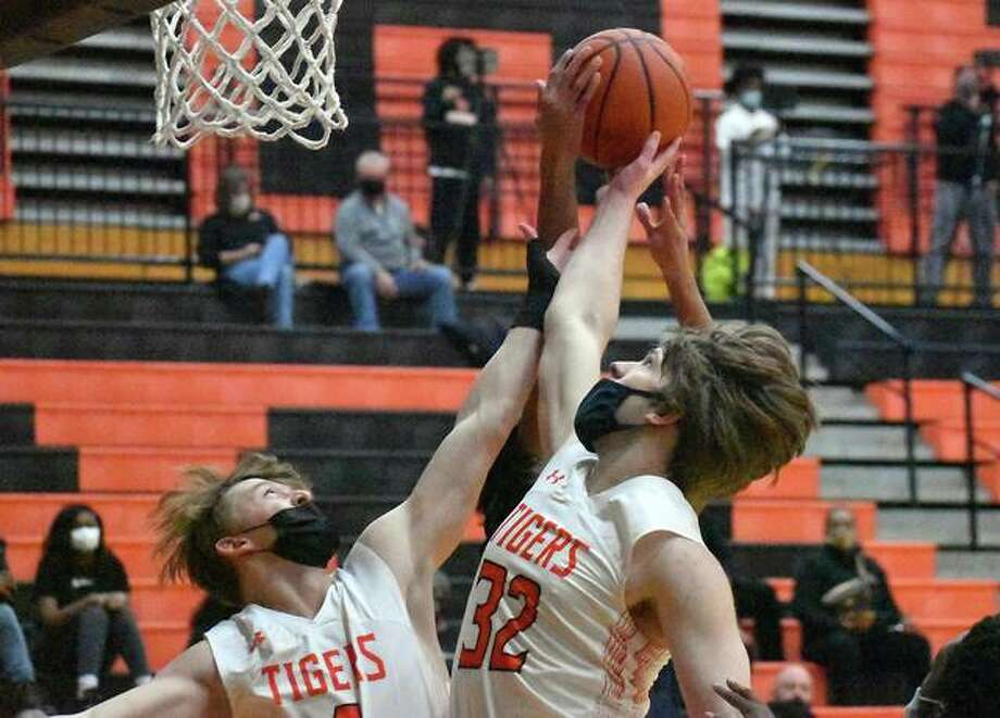 Edwardsville's Shaun Pacette, right, and Hayden Moore go up for a rebound in the first half of Tuesday's game against O'Fallon inside Lucco-Jackson Gymnasium in Edwardsville. Photo: Matt Kamp|The Intelligencer