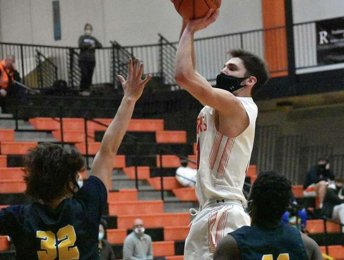 Edwardsville's Brennan Weller pulls up for a jump from the free-throw line in the first half.