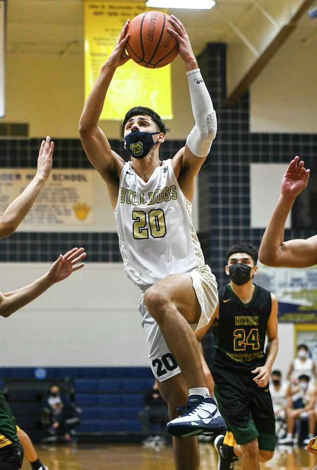 Jacob Rodriguez and Alexander won 77-67 at home Tuesday over Nixon in their final game of the regular season to secure at least a share of the District 30-6A title. Photo: Danny Zaragoza / Laredo Morning Times
