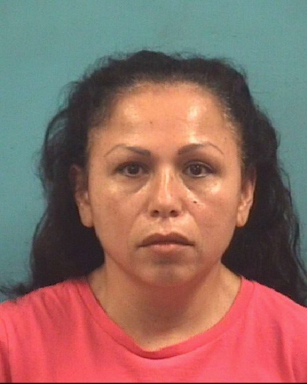 Floribeth Sandoval-Benjume was charged Tuesday with manslaughter in the death of HCSO Sgt. Bruce Watson, police said.