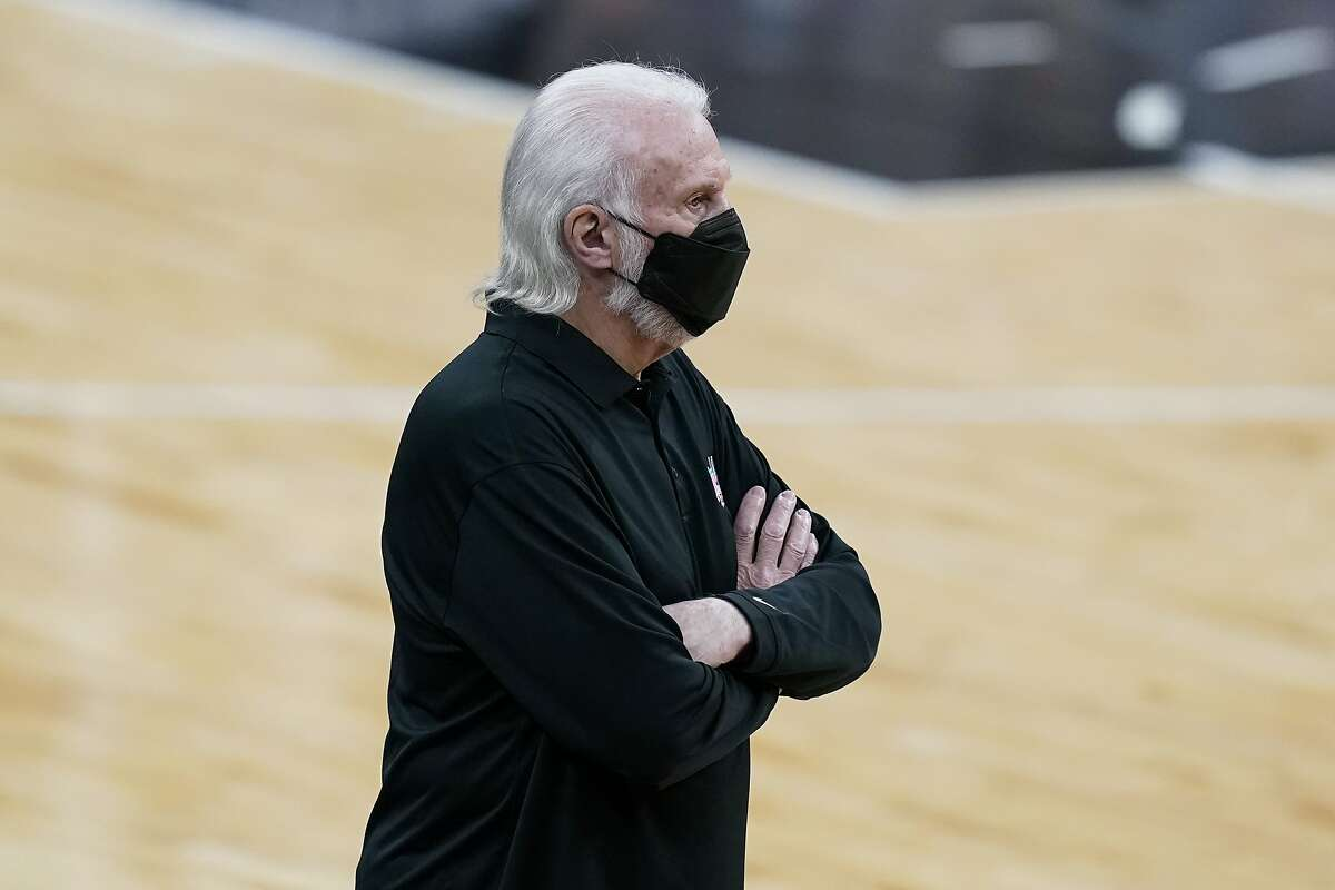 San Antonio Spurs head coach Gregg Popovich during the first half of an NBA basketball game against the Golden State Warriors in San Antonio, Tuesday, Feb. 9, 2021. (AP Photo/Eric Gay)