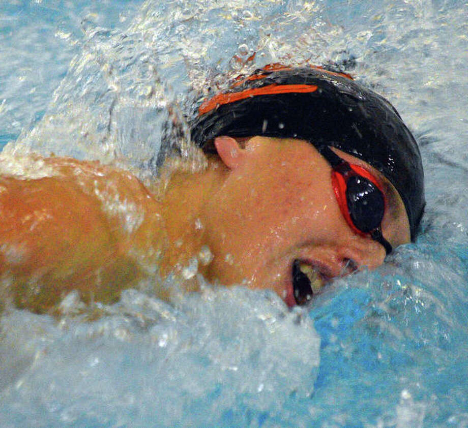 Edwardsville's Evan Grinter picked up a pair of individual wins and a relay victory in Tuesday's season-opening victory over O'Fallon inside the Chuck Fruit Aquatic Center. Photo: Scott Marion|The Intelligencer
