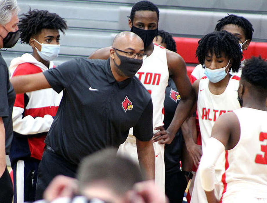 Alton coach Dana Morgan gives his team instructions during the first half of Tuesday night's Southwestern Conference gmae against East St. Louis at AHS in Godfrey. Photo: Pete Hayes | The Telegraph