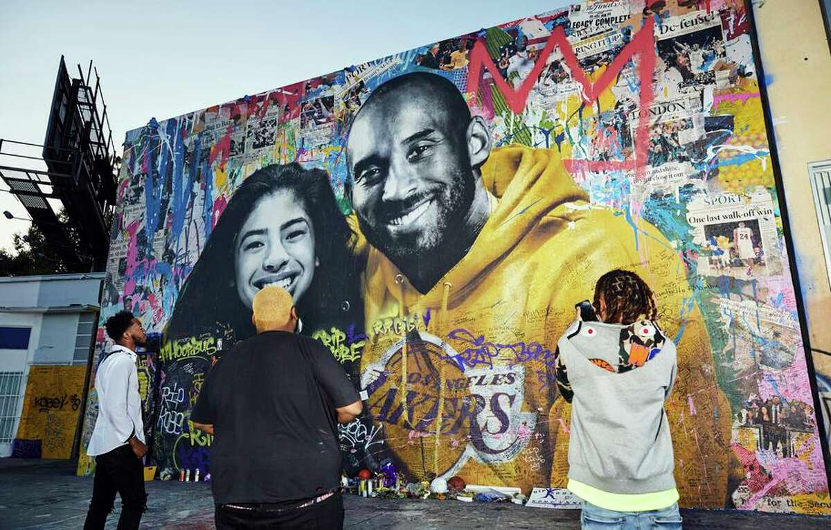 A mural by artist Mr. Brainwash featuring Kobe Bryant and his daughter, Gianna, in Los Angeles.