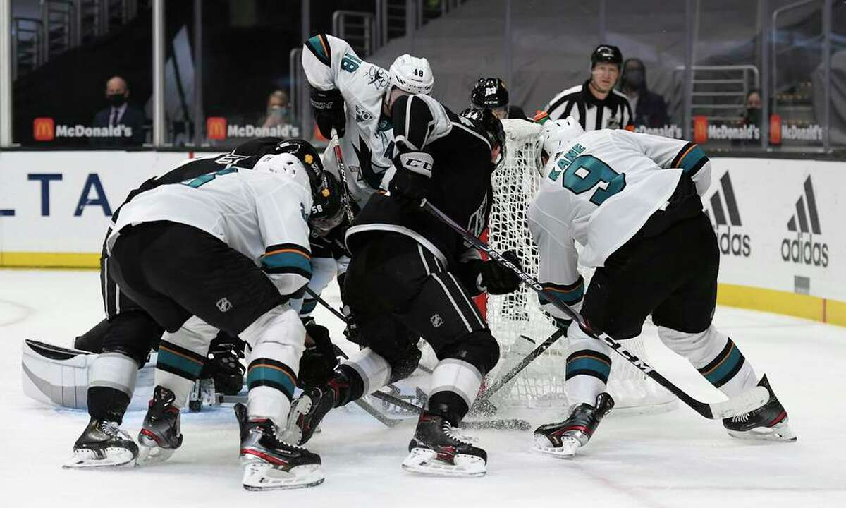 The Sharks' Evander Kane (9) scores in the final minute of regulation to tie Los Angeles 3-3 and send the game to OT.