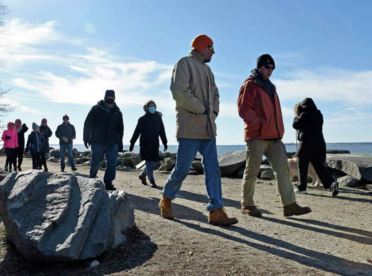 A mass of people walk the Tod's Driftway loop at Greenwich Point Park in Old Greenwich, Conn. Sunday, Jan. 10, 2021.