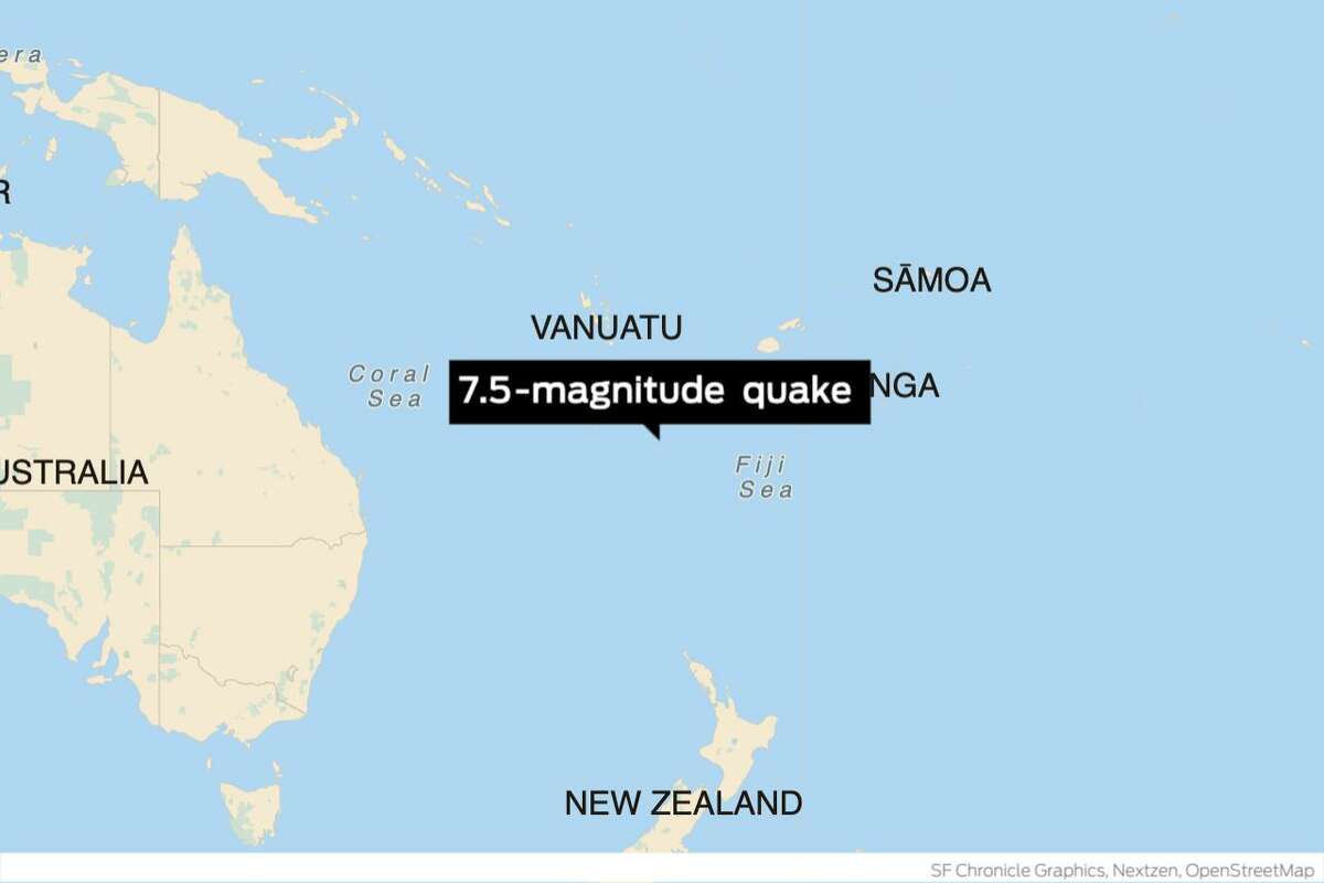 Federal officials were reviewing potential tsunami threats to the U.S. and Canada after a massive earthquake struck an area southeast of the Loyalty Islands near Australia Wednesday morning