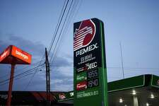 Signage with fuel prices at a Petroleos Mexicanos (Pemex) gas station in San Luis Potosi, Mexico, on Tuesday, Jan. 19, 2021. Mexican PresidentAndres Manuel Lopez Obradorhas sought to clamp down on private competition to state-owned companies, saying in October he intends to protect the interests of state oil producer Petroleos Mexicanos and electricity firm Comision Federal de Electricidad. At the time, he accused foreign companies of ransacking the country. Photographer: Mauricio Palos/Bloomberg