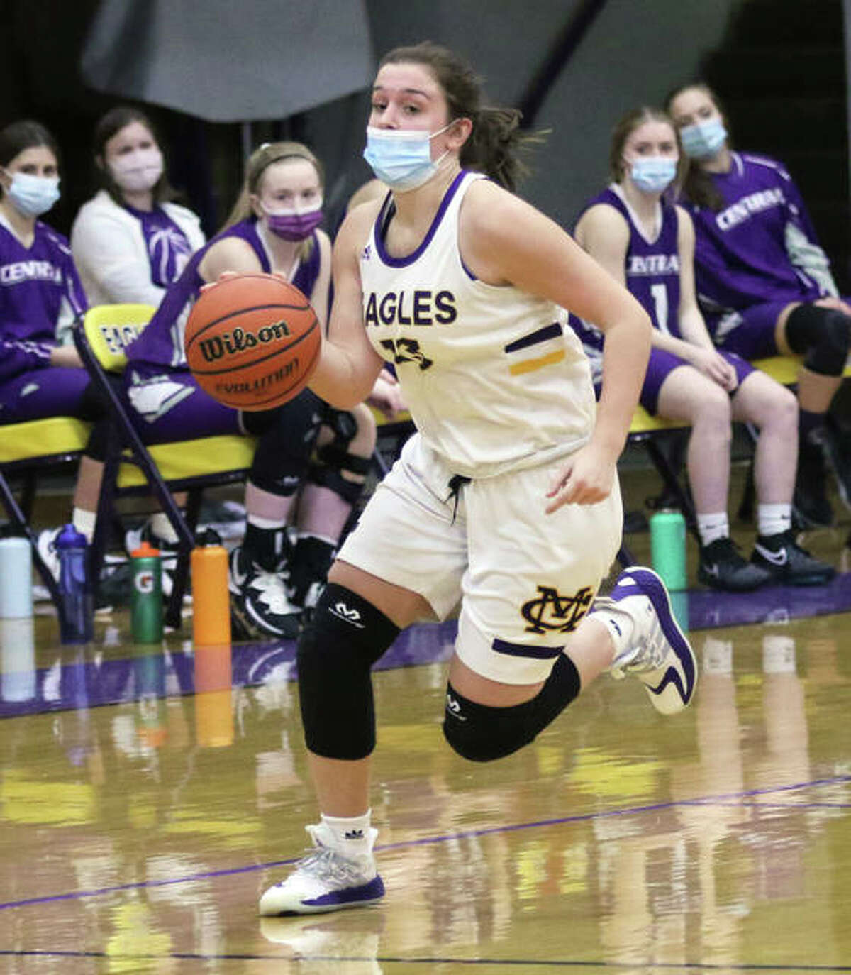 CM's Harper Buhs, playing in her first game since surgery for a torn ACL ended her junior season in December 2019, pushes the ball upcourt in transition Tuesday night in Bethalto.