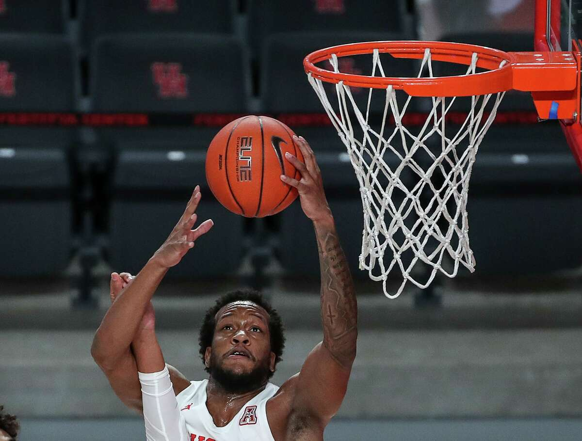 UH senior forward Justin Gorham (4) leads the AAC with 10.2 rebounds per game, and his average of 4.69 offensive boards ranks second nationally.