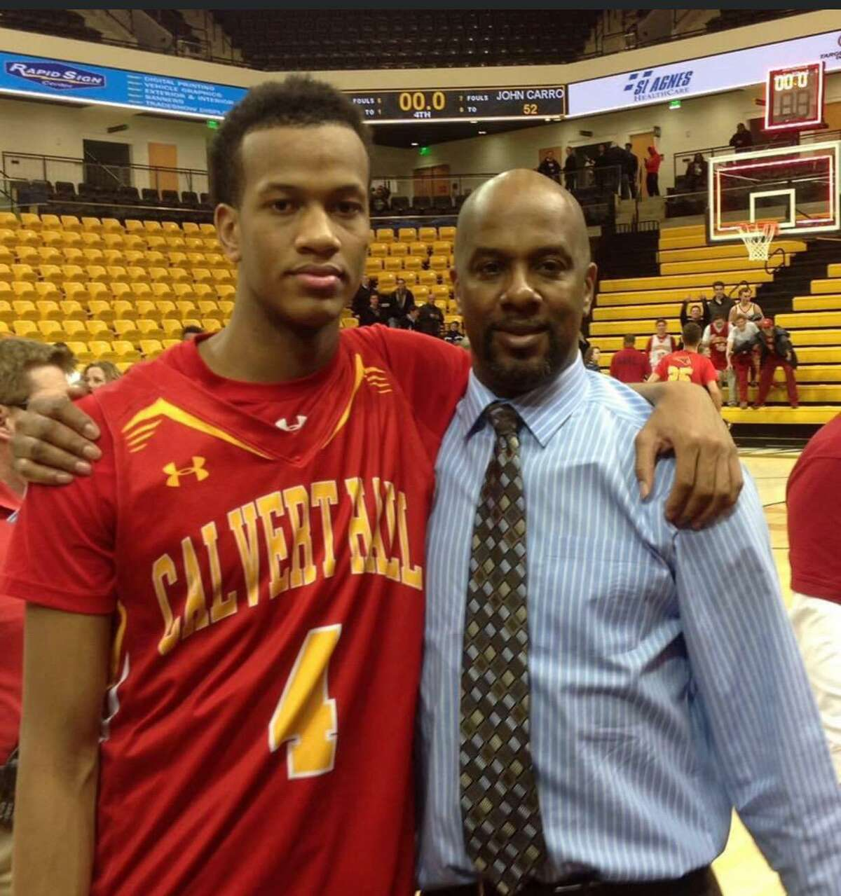 Justin Gorham, left, and his father Jerry bonded over basketball. Jerry died of cancer in 2016.
