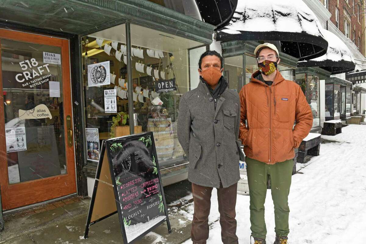 Hernan Lopez of Alias coffee products, left, and Oliver Holecek from Primo Botanica chocolate stand in front of their stores housed in 518 Craft taproom on Tuesday, Feb. 9, 2021 in Troy, N.Y. (Lori Van Buren/Times Union)