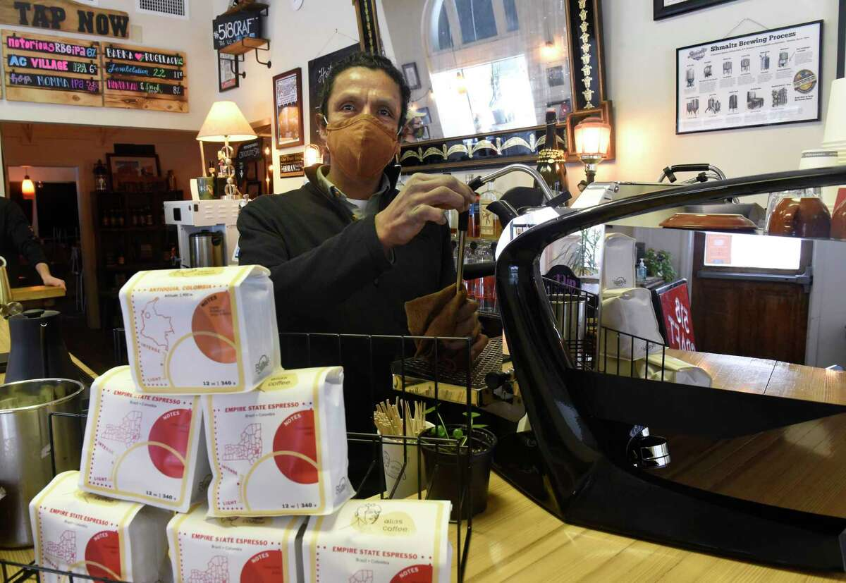 Hernan Lopez of Alias coffee products stands behind his coffee bar housed in 518 Craft taproom on Tuesday, Feb. 9, 2021 in Troy, N.Y. (Lori Van Buren/Times Union)