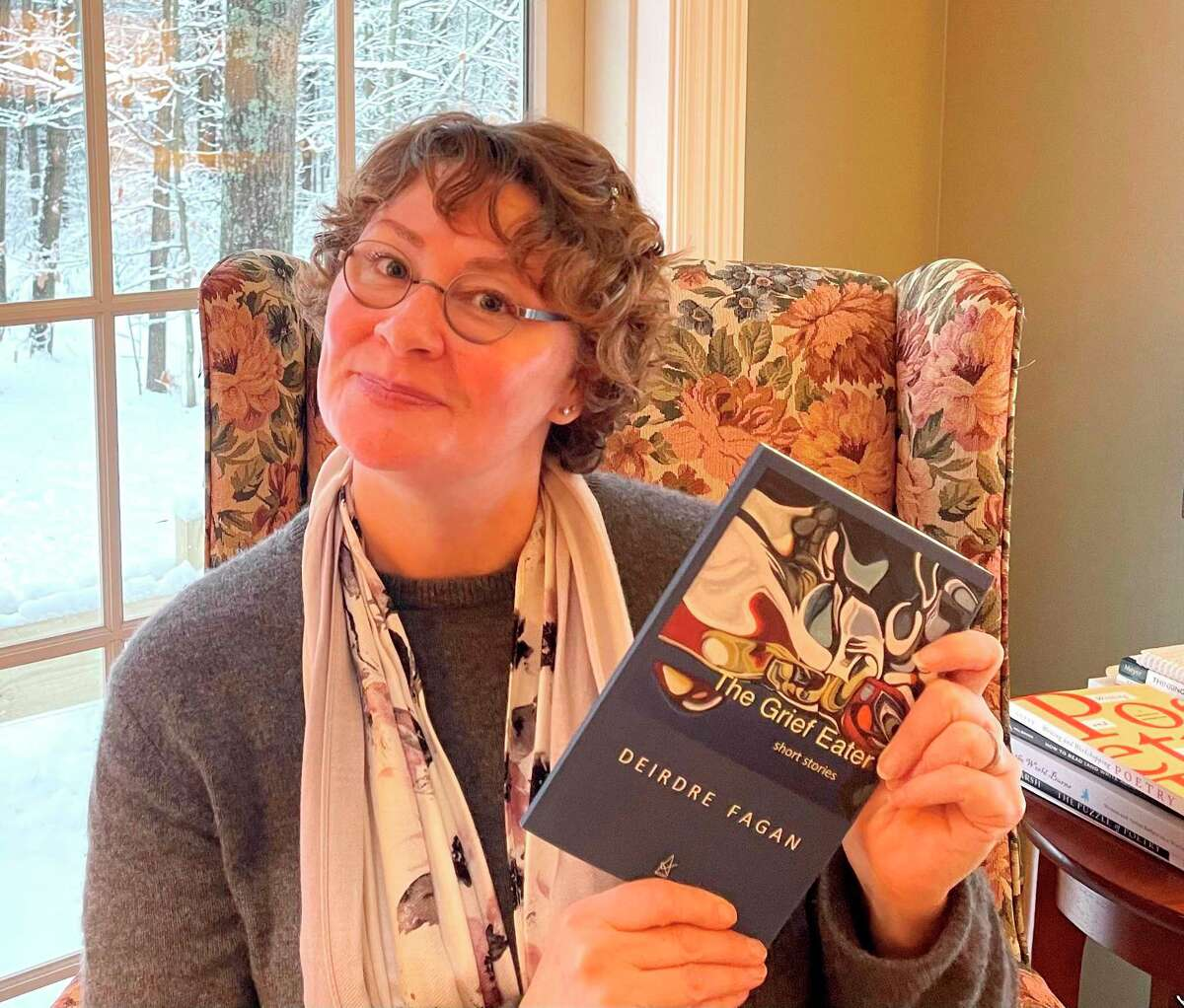 Associate Professor of English, Literature and World Languages Deirdre Fagan, Ferris State University's creative writing coordinator, holds a copy of her latest work,