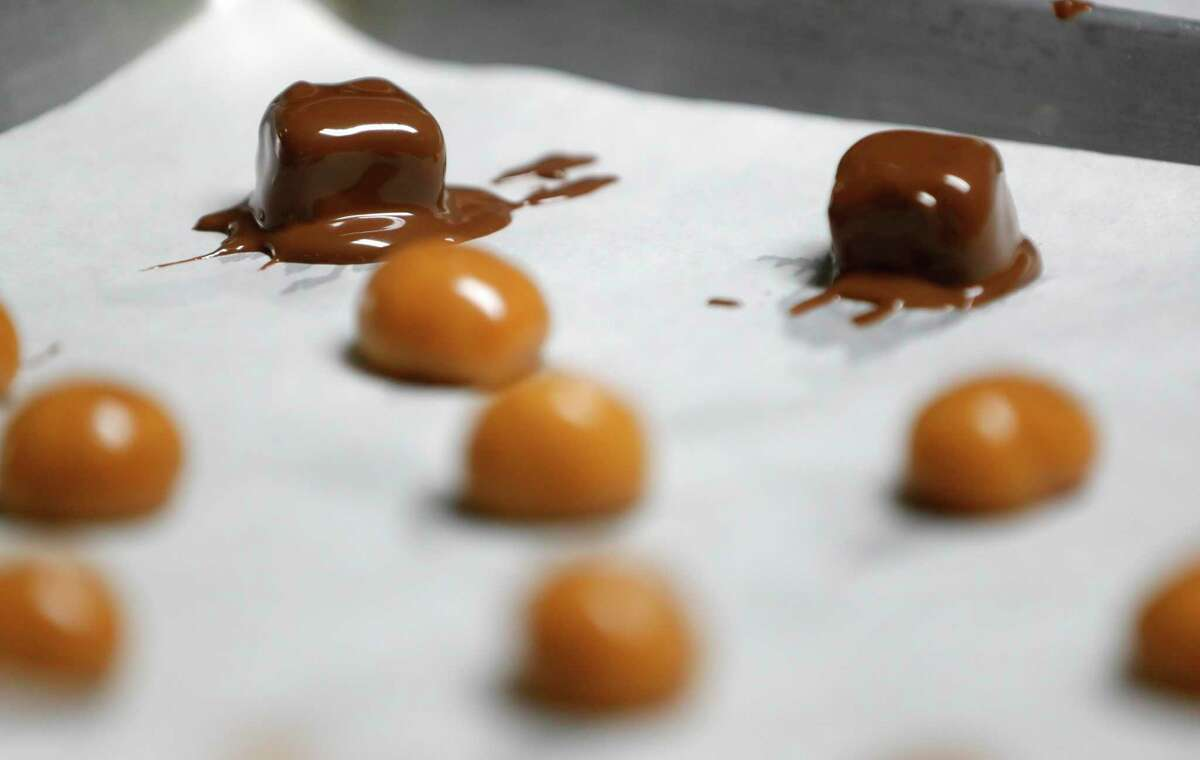 Chocolate-covered caramels are seen at Chocolate Passion, Tuesday, Feb. 9, 2021, in Conroe.