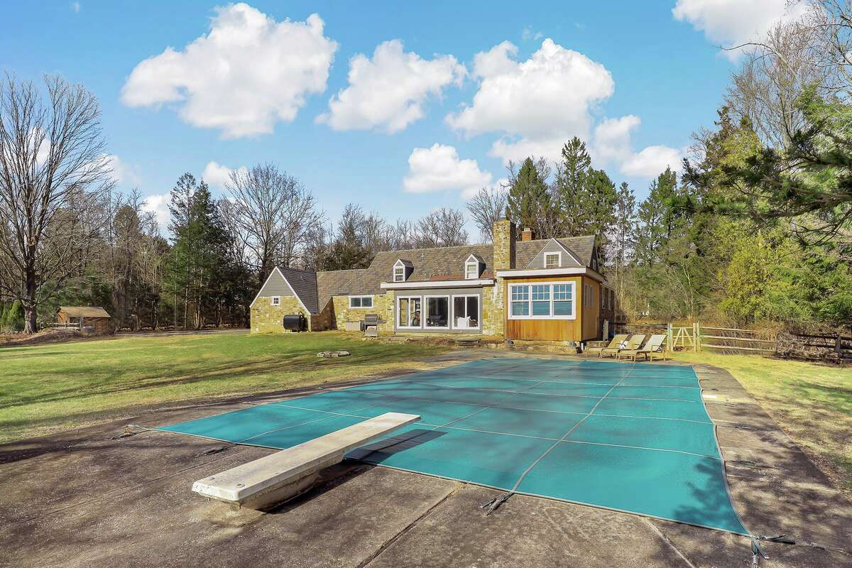 In-ground swimming pool with diving board at 3 Kettle Creek Road, Weston.