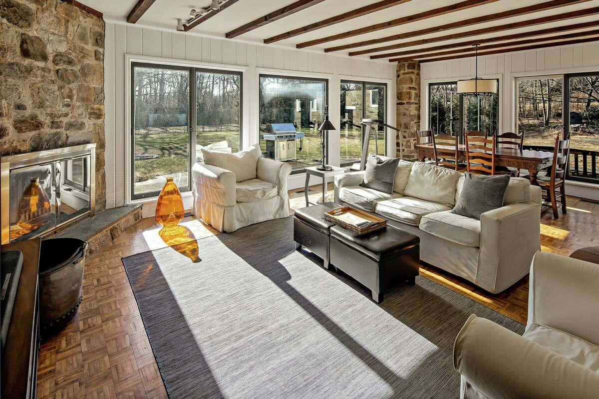 Family room with sliding door to the two-acre level property at 3 Kettle Creek Road, Weston.