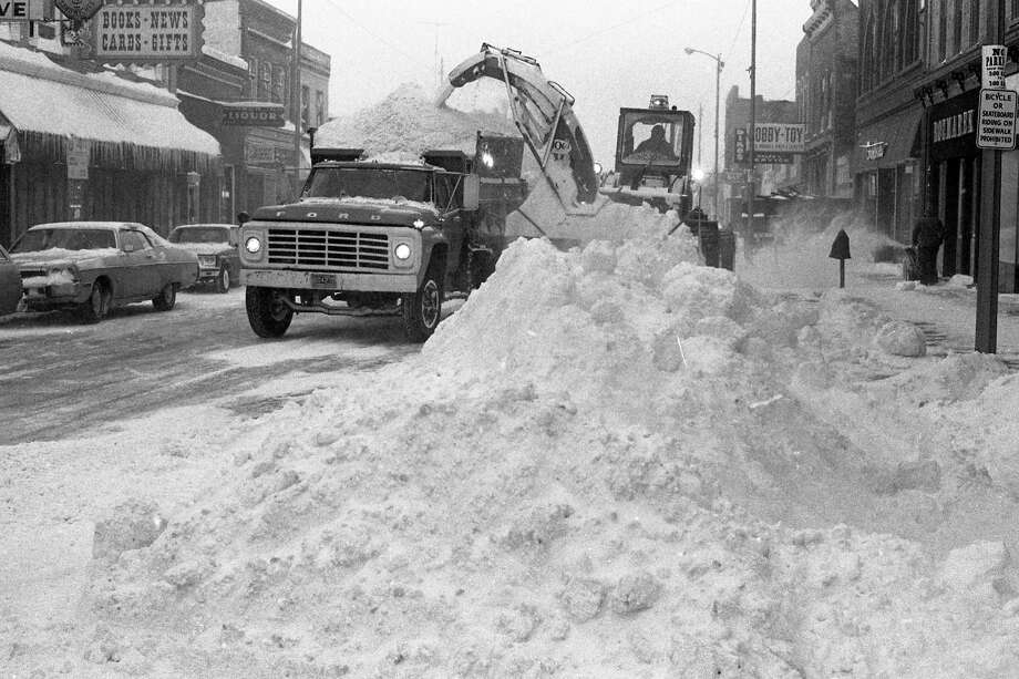 From the front page of the News Advocate on this day in 1981: Once again it's dig out time and Manistee City Department of Public Works employees went right to it early this morning, clearing River Street of the more than eight inches of snow that had fallen last night. (Manistee County Historical Museum photo)