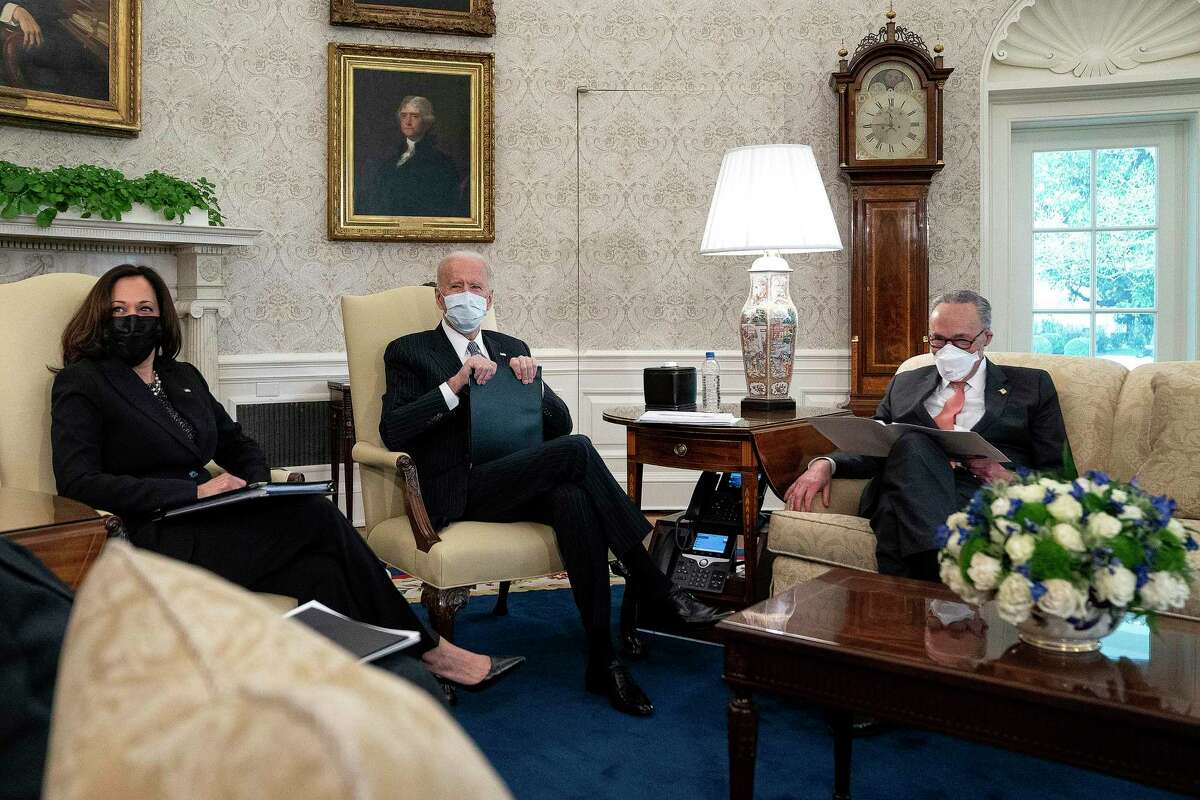 U.S. President Joe Biden, center, and Vice President Kamala Harris, right, meet with Senate Majority Leader Charles Schumer, D-N.Y., and other Democratic senators to discuss his $1.9 trillion American Rescue Plan in the Oval Office at the White House on Wednesday, Feb. 3, 2021, in Washington, D.C. (Stefani Reynolds/Pool/Getty Images/TNS)