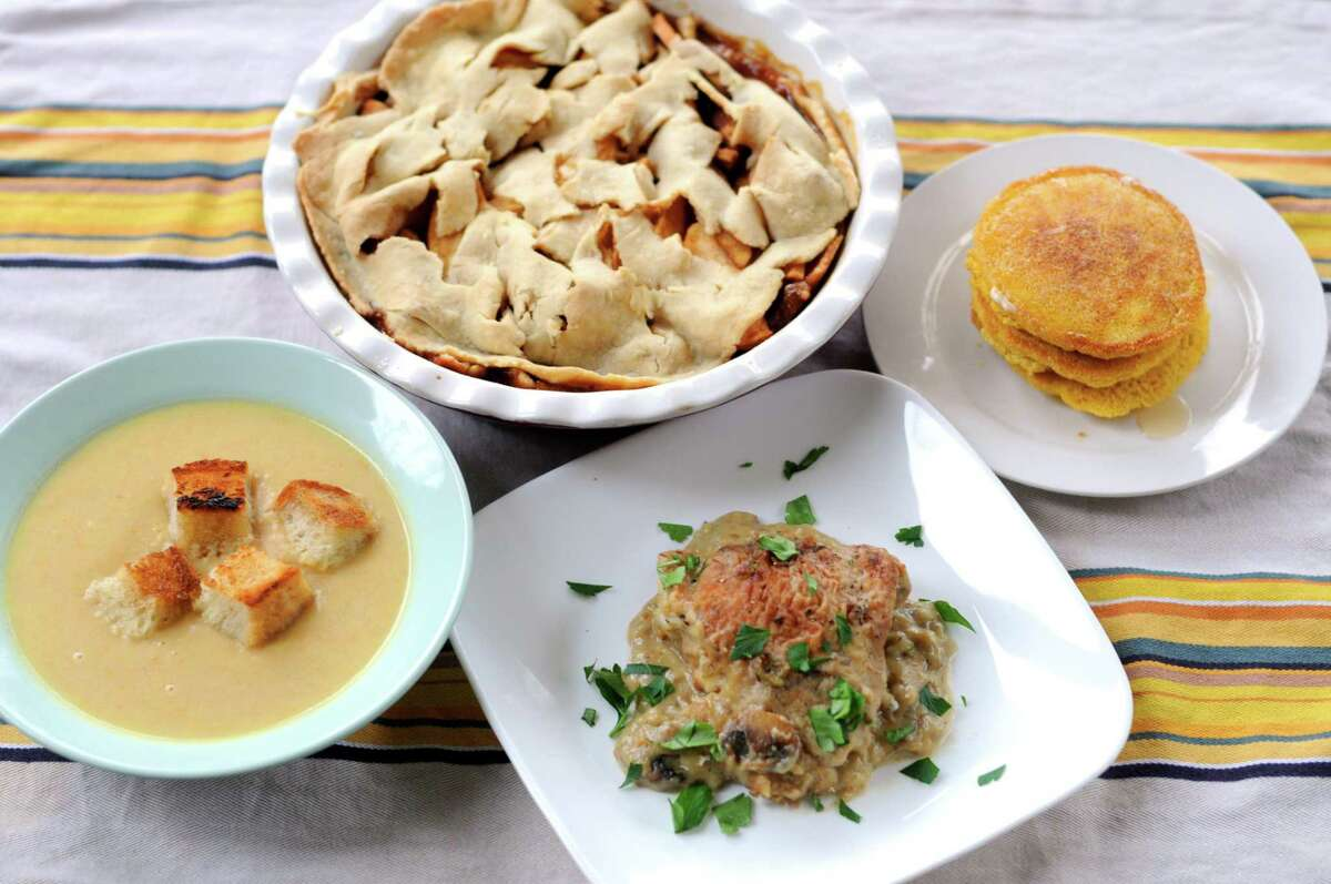 Clockwise from bottom: Abraham Lincoln's Chicken Fricassee, Mount Vernon Hoecakes, Abigail Adams' Apple Pan Dowdy and Monticello White Bean Soup were all favored dishes of past presidents.